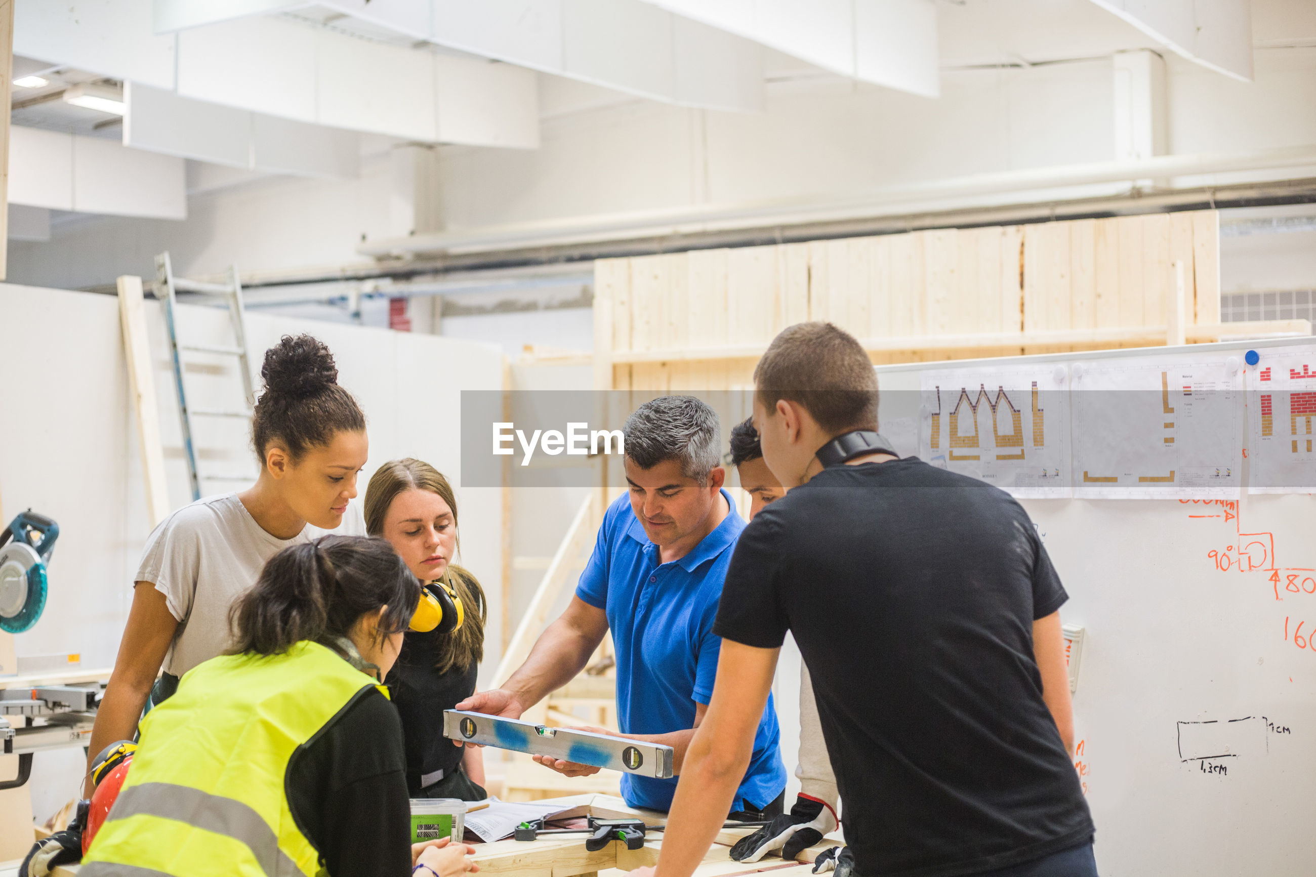 GROUP OF PEOPLE WORKING IN SHOPPING MALL