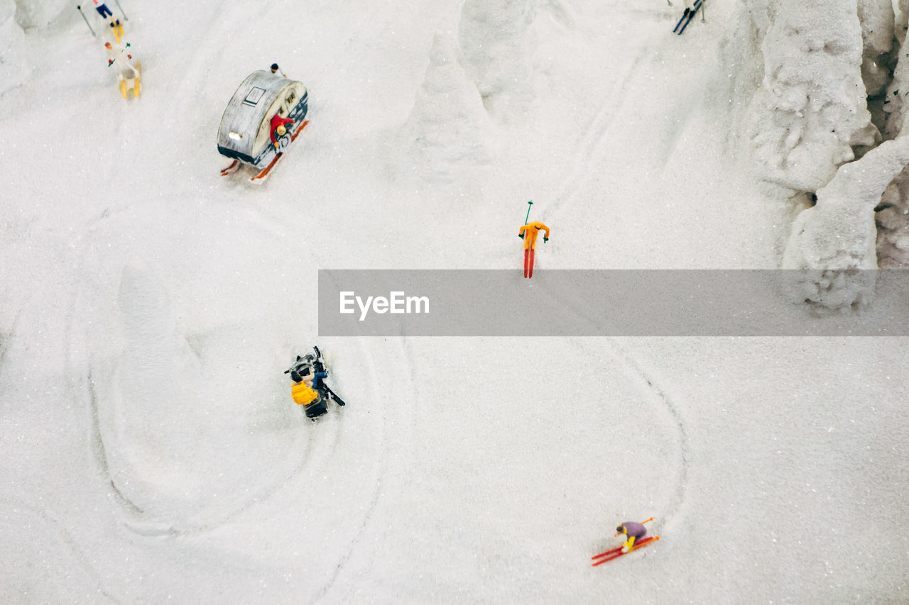 High Angle View Of People Skiing In Snowy Area