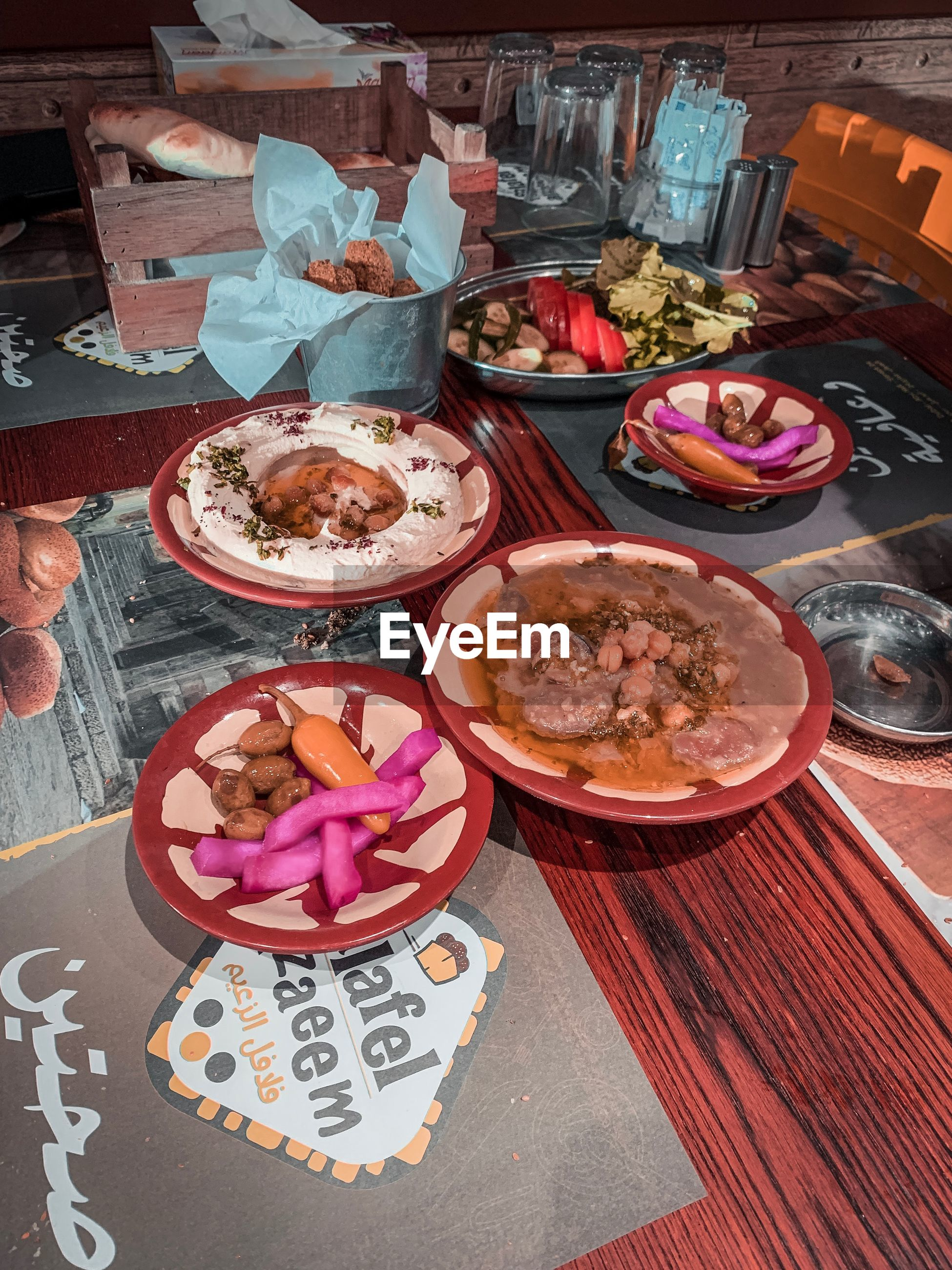 food and drink, food, table, freshness, high angle view, plate, ready-to-eat, choice, text, indulgence, variation, meat, no people, unhealthy eating, indoors, still life, bowl, western script, temptation, glass