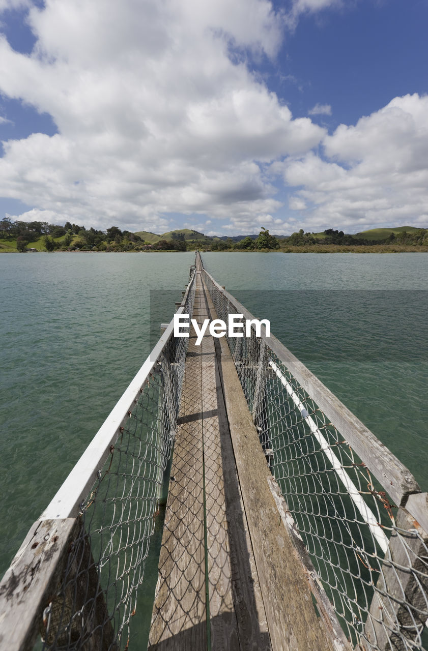water, cloud - sky, sky, direction, nature, day, the way forward, lake, beauty in nature, railing, scenics - nature, no people, tranquility, connection, tranquil scene, outdoors, built structure, bridge, diminishing perspective