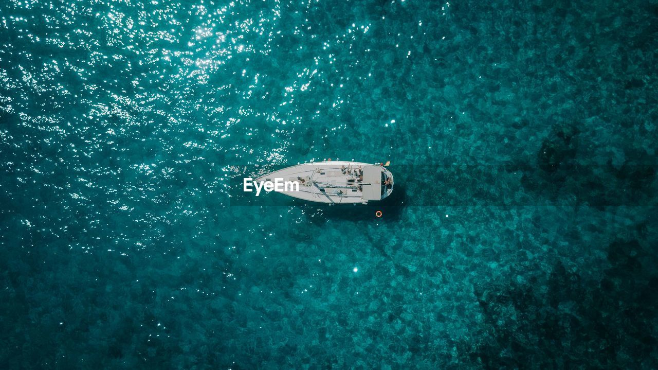 High angle view of sailboat on sea during sunny day