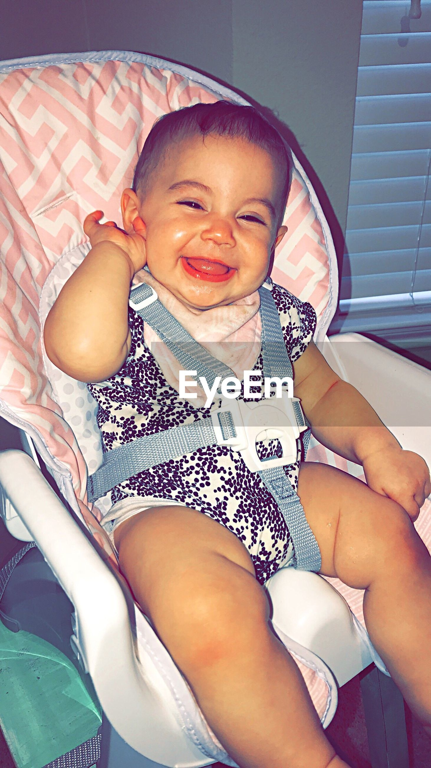baby, real people, cute, happiness, babyhood, childhood, front view, new life, smiling, lifestyles, portrait, home interior, indoors, looking at camera, sitting, full length, cheerful, bonding, day, fragility, human hand, close-up, people