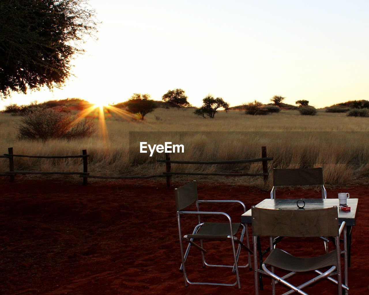 table, chair, sunset, landscape, tree, field, clear sky, no people, nature, outdoors, scenics, grass, sky, beauty in nature, day
