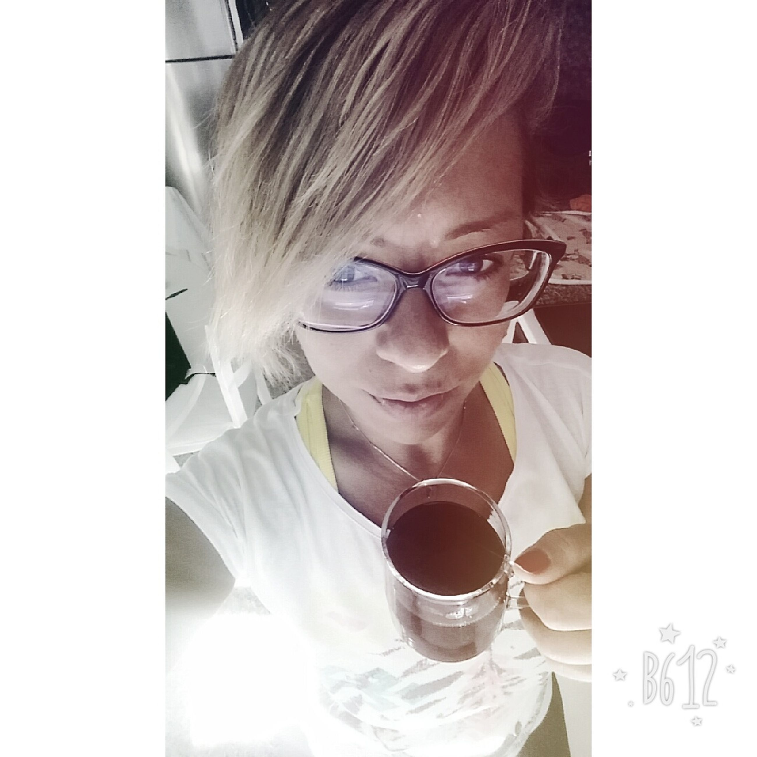 eyeglasses, coffee cup, one person, drink, food and drink, holding, real people, indoors, freshness, close-up, young adult, day, people