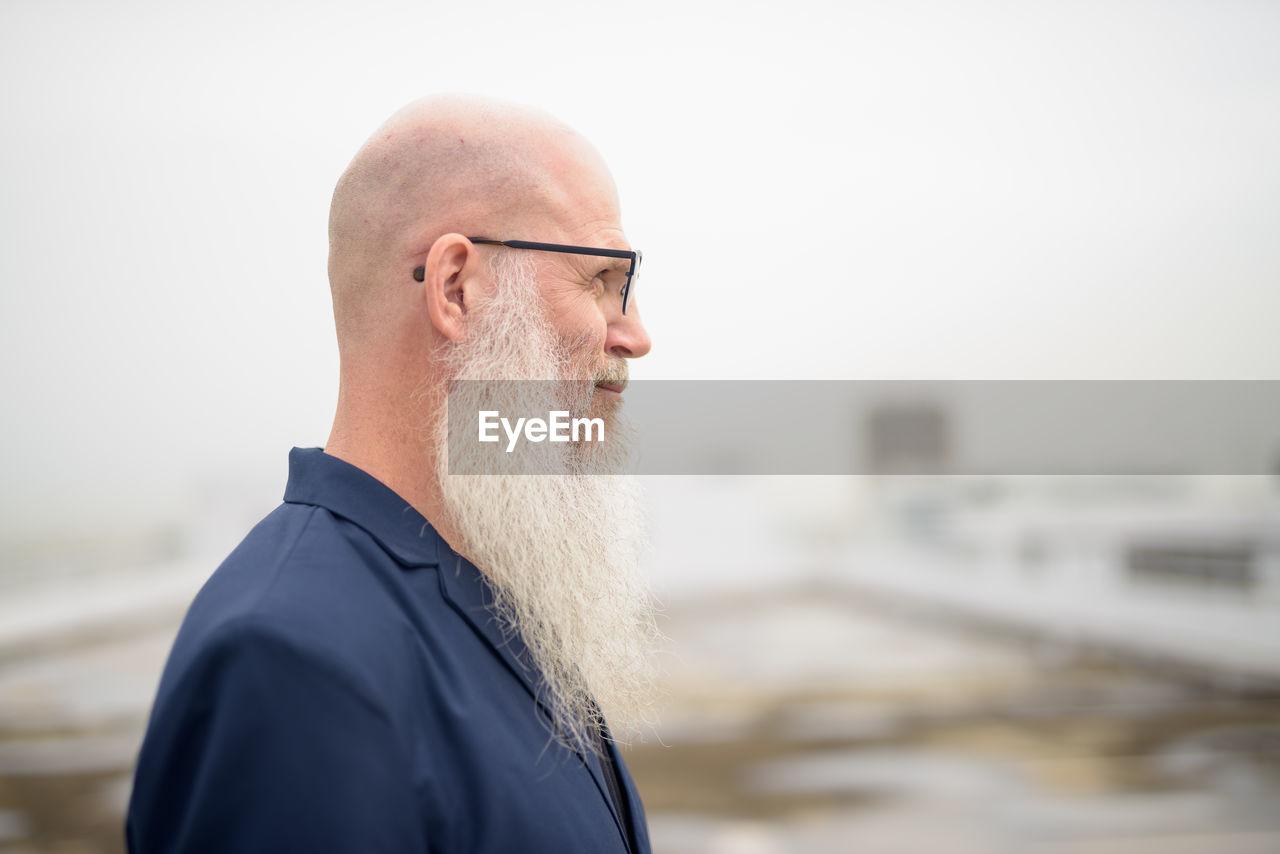 Portrait of man wearing hat against sea