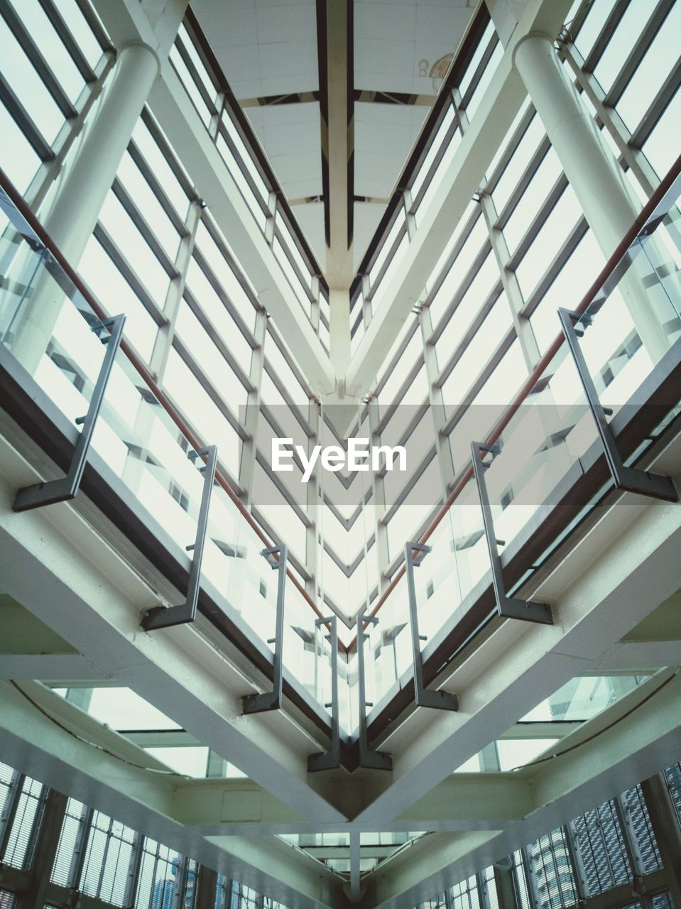 indoors, architecture, ceiling, built structure, low angle view, no people, modern, day, white color, pattern, white, architectural feature, window, lighting equipment, building, in a row, skylight, illuminated, glass - material, directly below