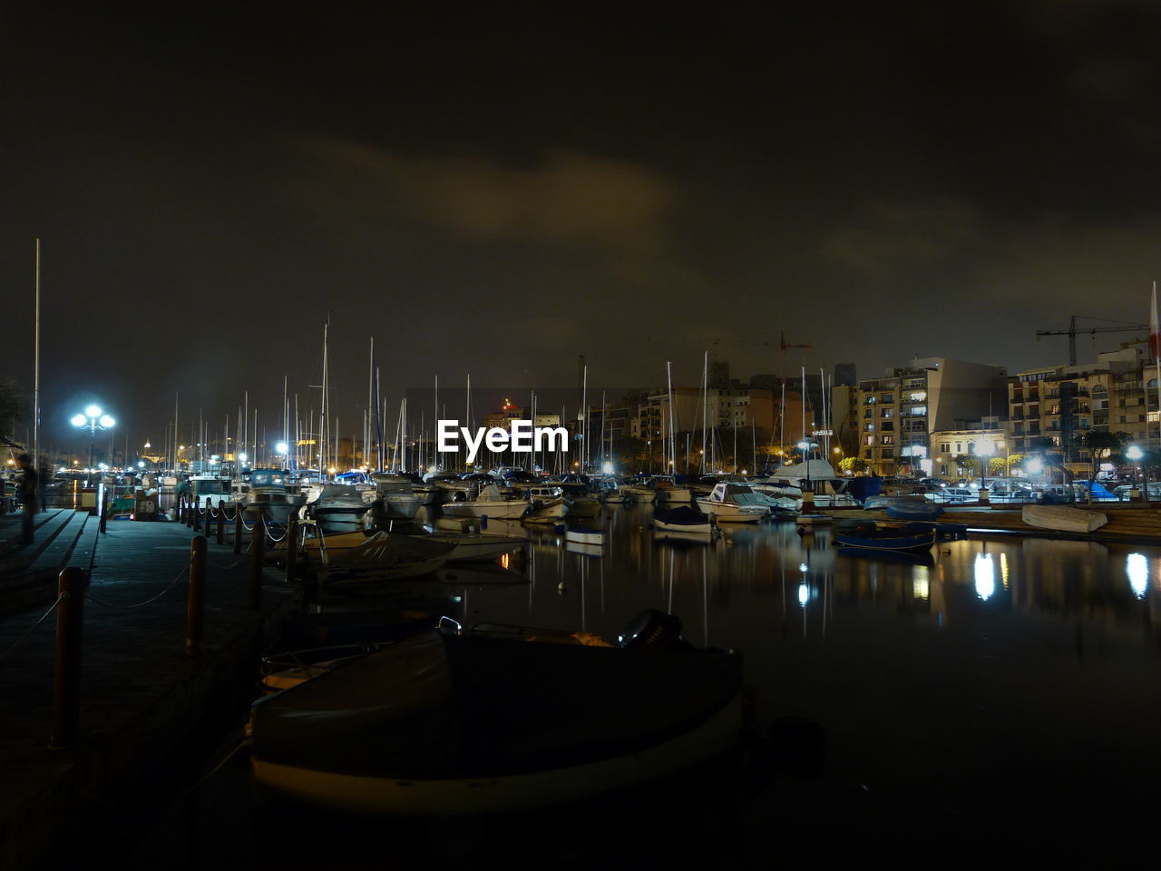 nautical vessel, moored, mode of transportation, night, transportation, illuminated, harbor, water, sailboat, sky, mast, sea, nature, no people, architecture, city, cloud - sky, yacht, pole, port, marina, anchored