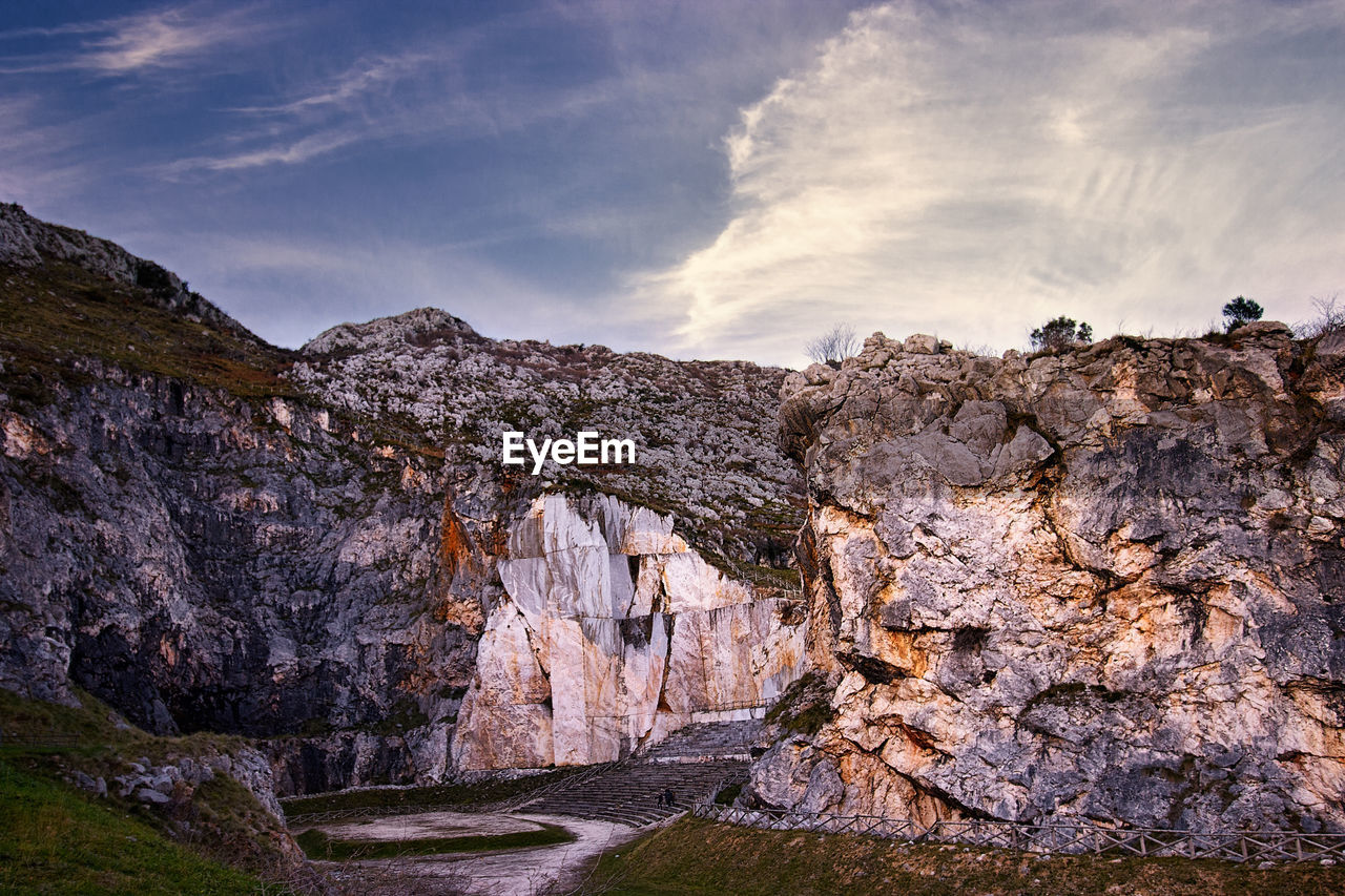 rock - object, rock formation, geology, cloud - sky, landscape, nature, mountain, beauty in nature, no people, sky, outdoors, day, scenics, arid climate