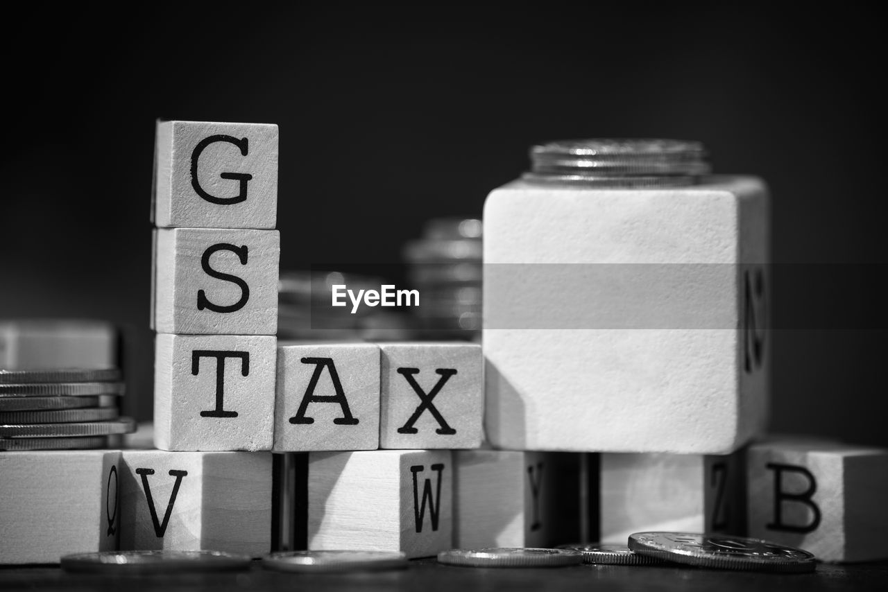 Close-Up Of Gst Text On Wooden Blocks
