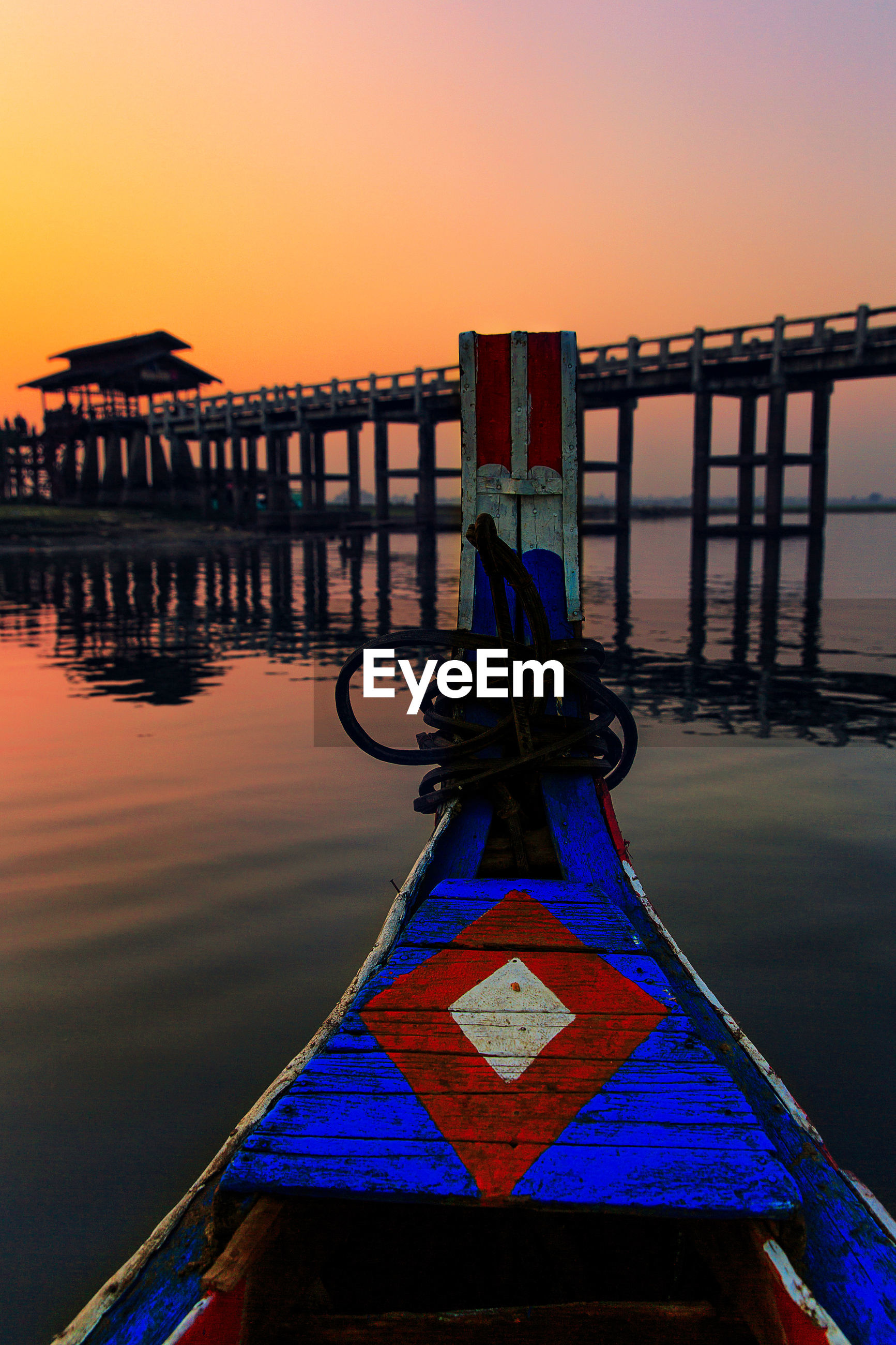 VIEW OF PIER IN SEA AT SUNSET