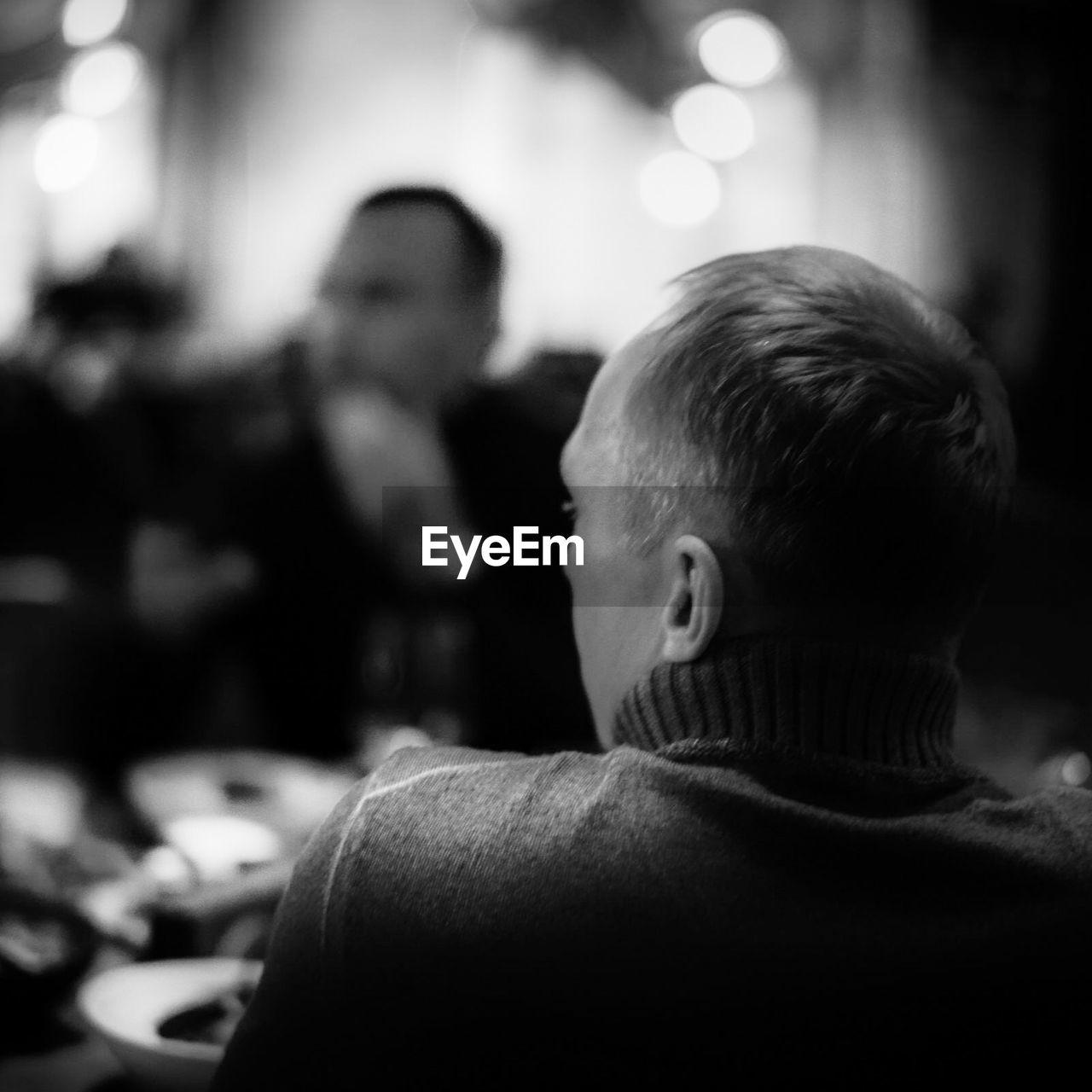 Rear view of man sitting in restaurant