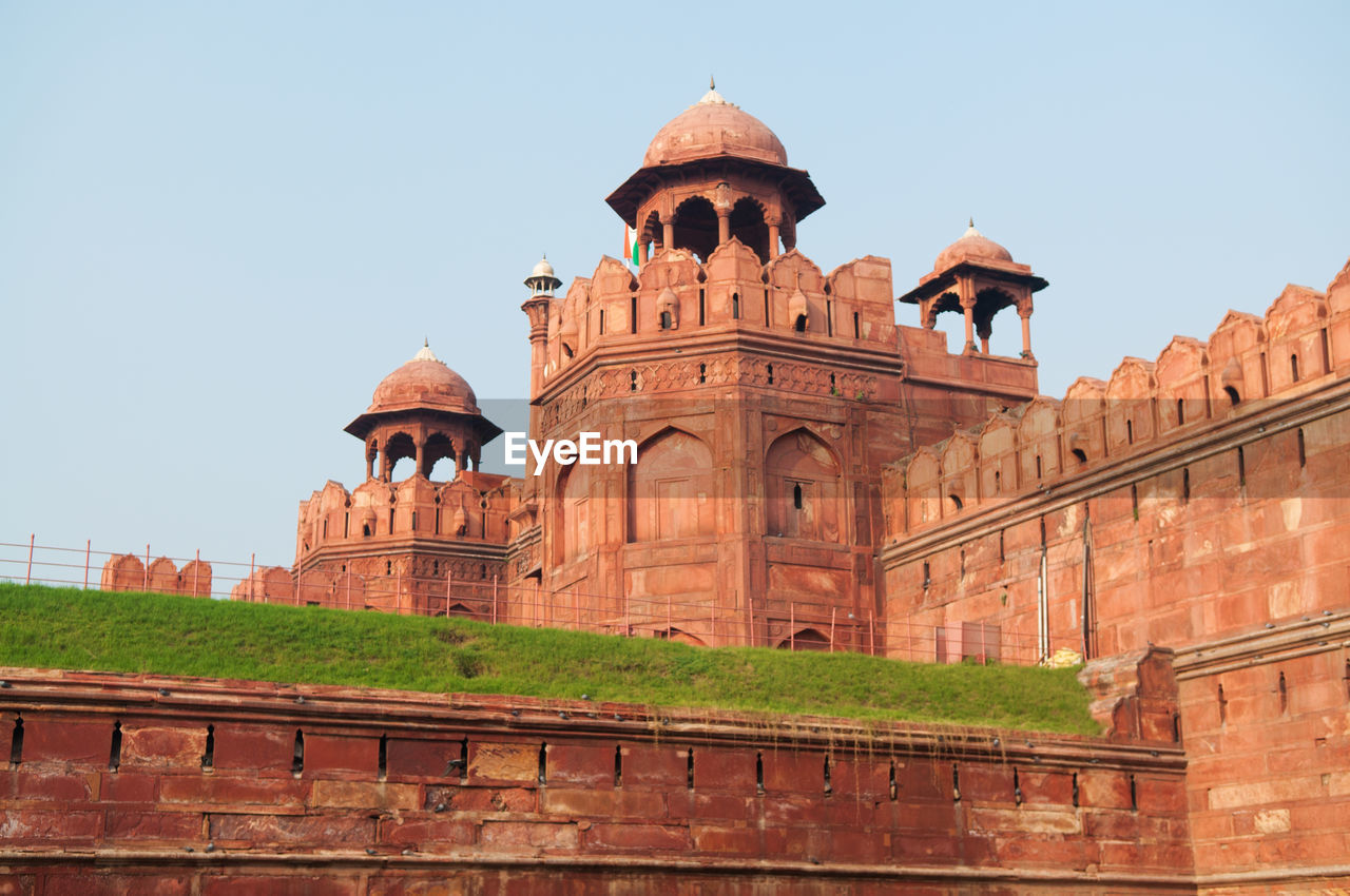 Low angle view of red fort against sky