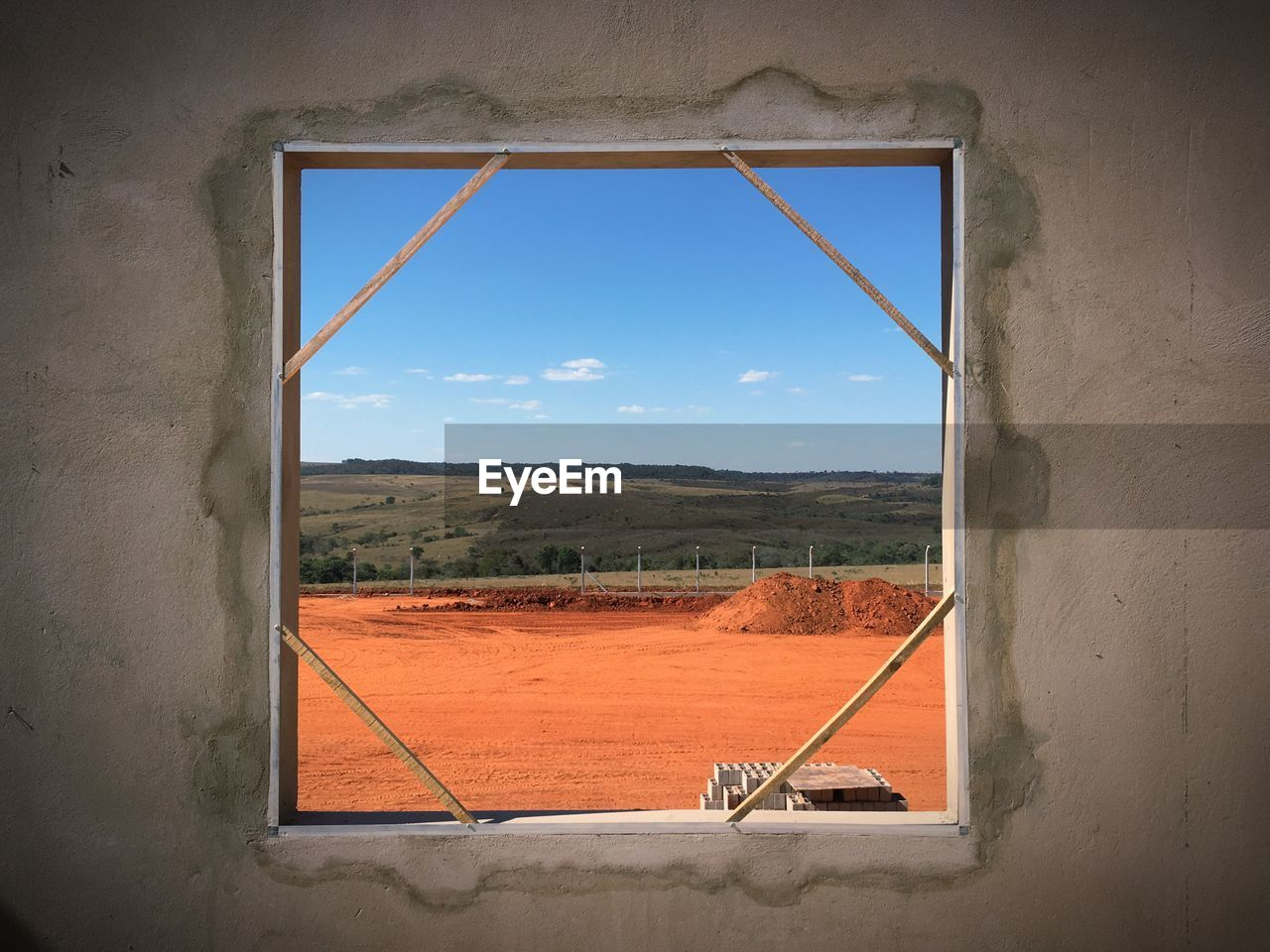 Scenic View Of Landscape Against Sky Seen Through Window