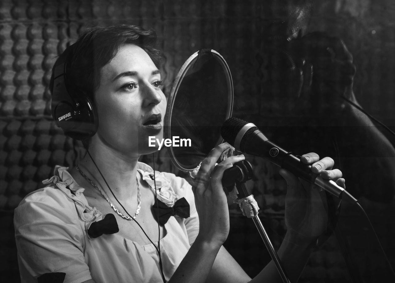 Close-Up Of Woman Singing
