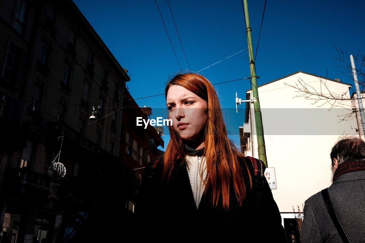 real people, outdoors, clear sky, young women, lifestyles, young adult, building exterior, architecture, day, one person, sky