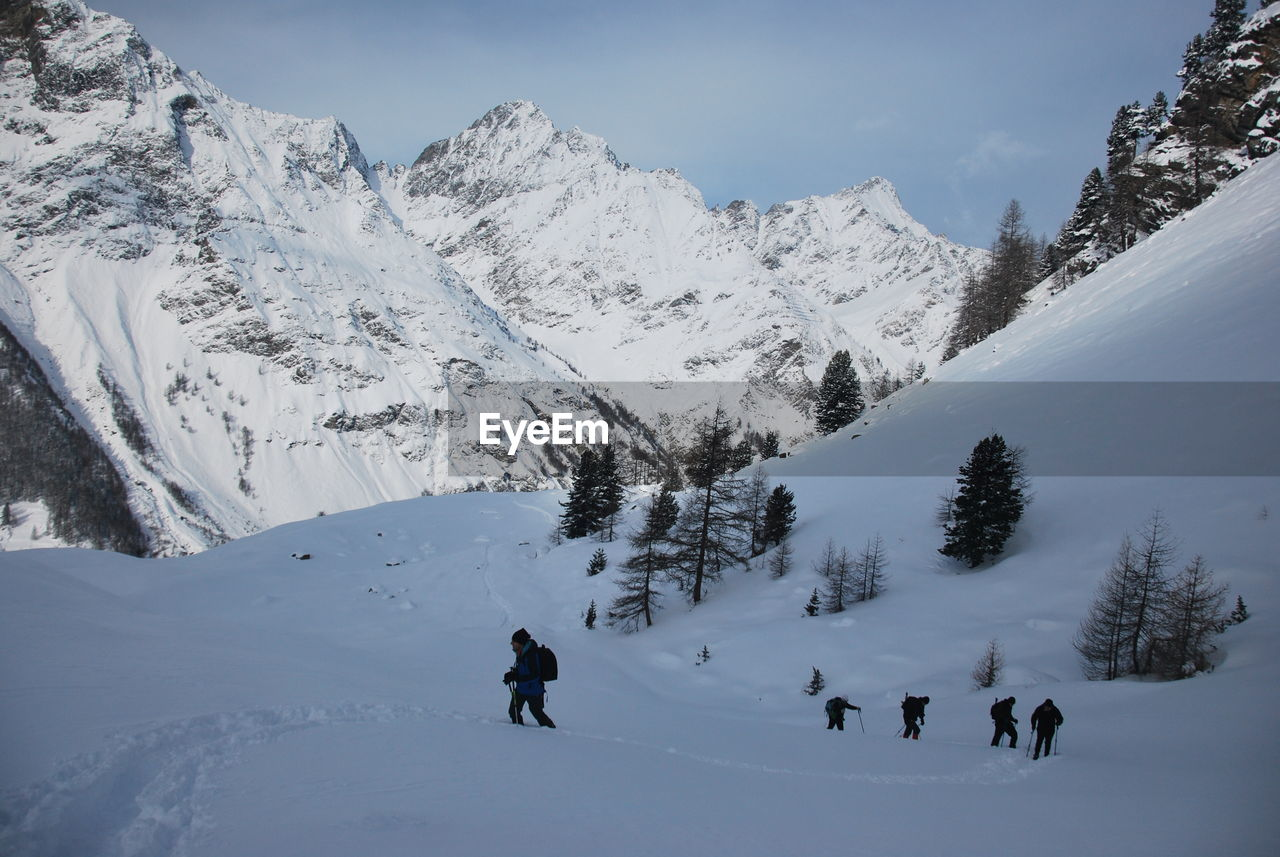 People On Snow Covered Mountain During Winter