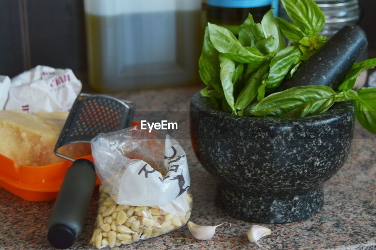 Preparing pesto in traditional mortar