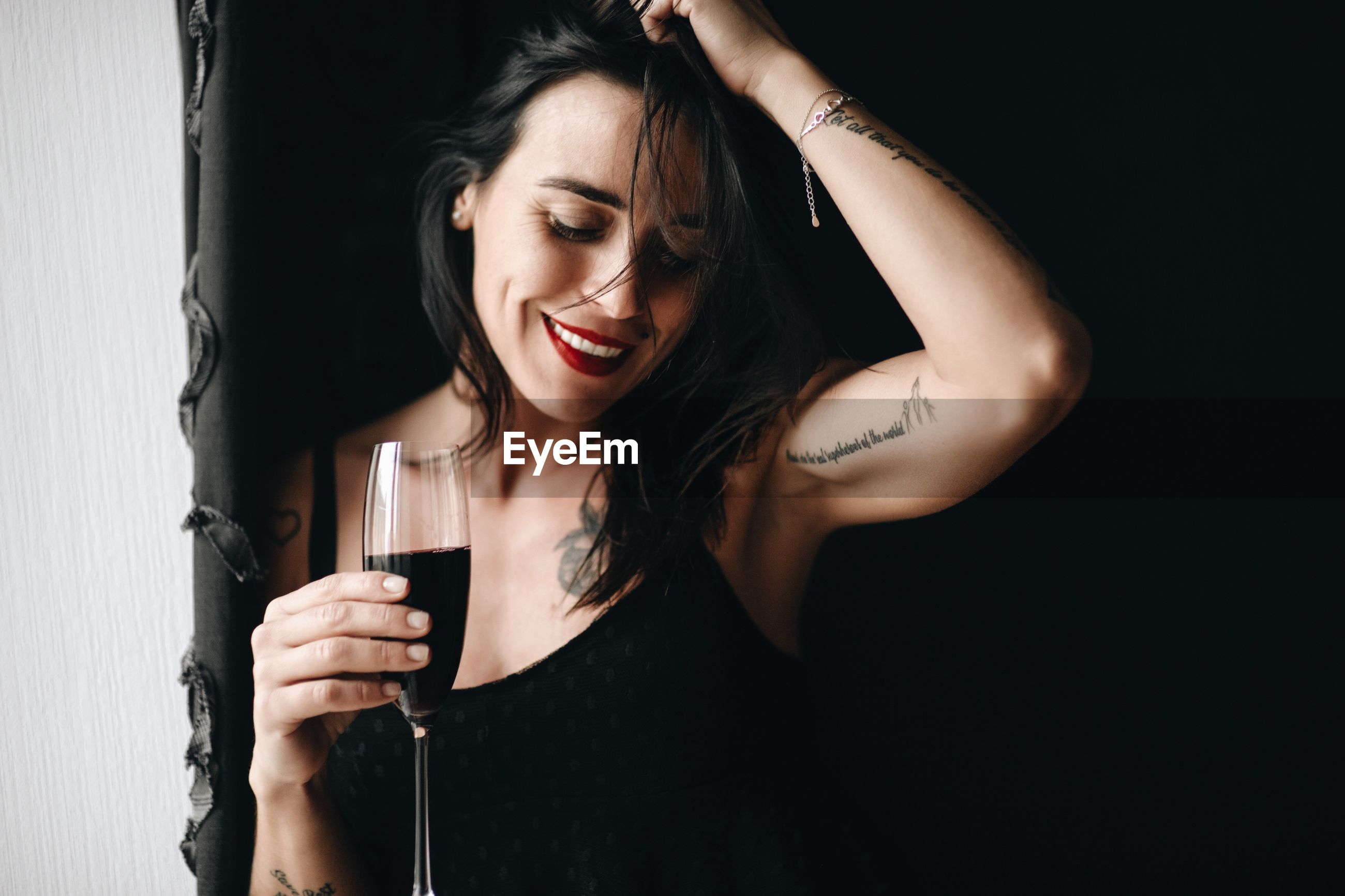 Smiling woman holding wineglass