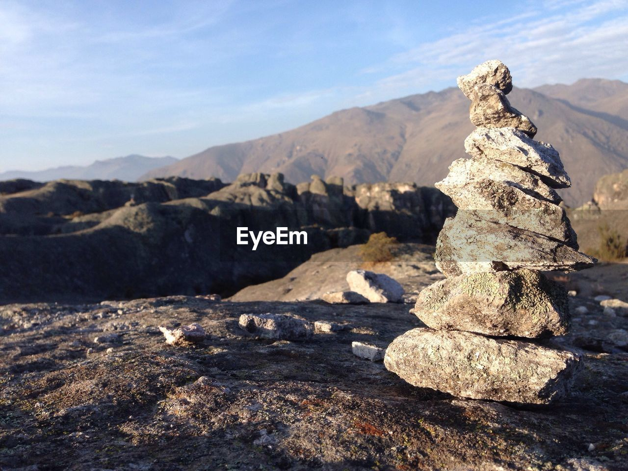 Close-up of stacked rocks against mountains