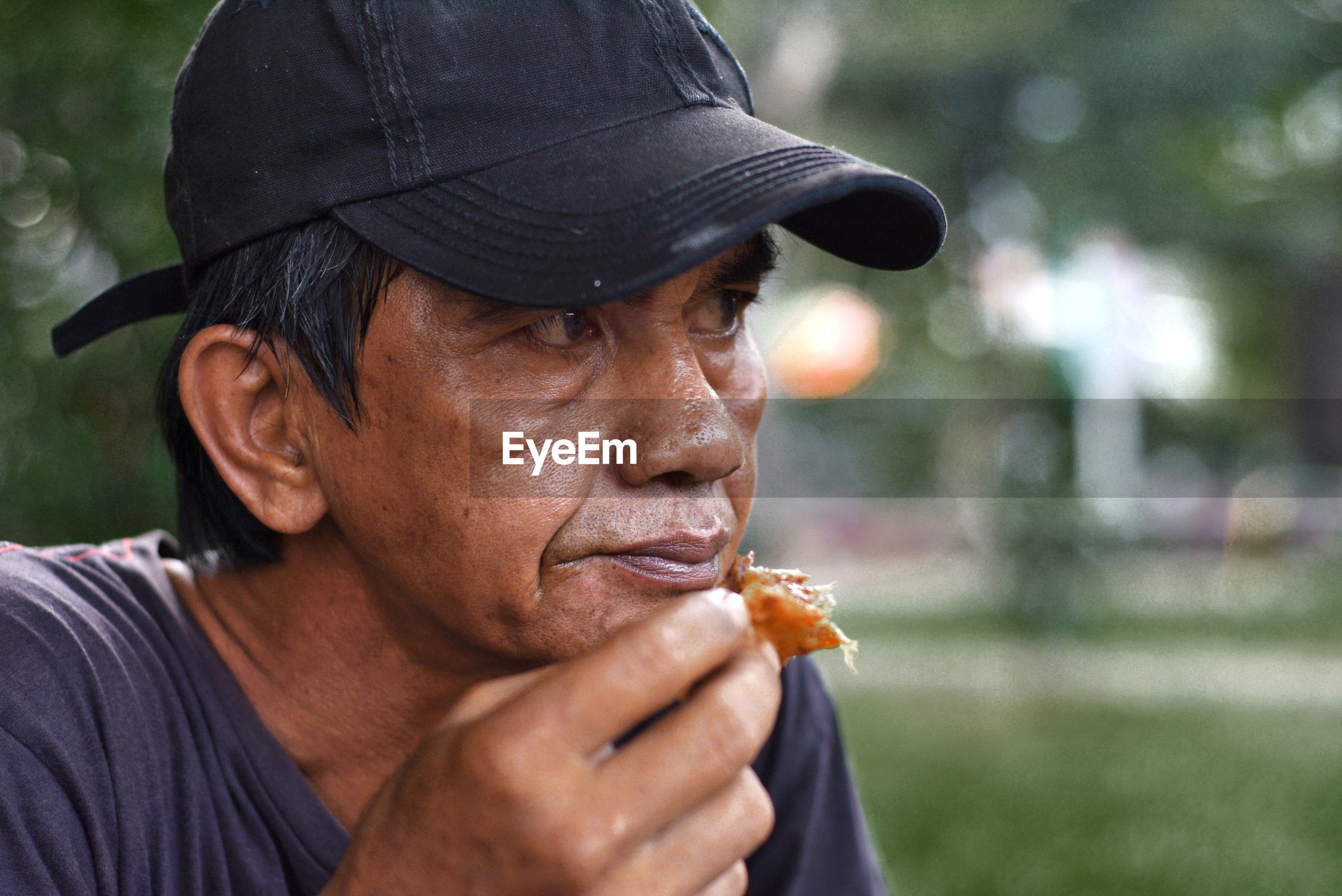 Close-up of thoughtful mature man eating food
