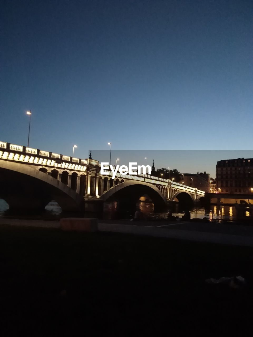sky, architecture, built structure, bridge, connection, transportation, bridge - man made structure, building exterior, copy space, city, nature, illuminated, clear sky, night, street, outdoors, mode of transportation, water, street light, river