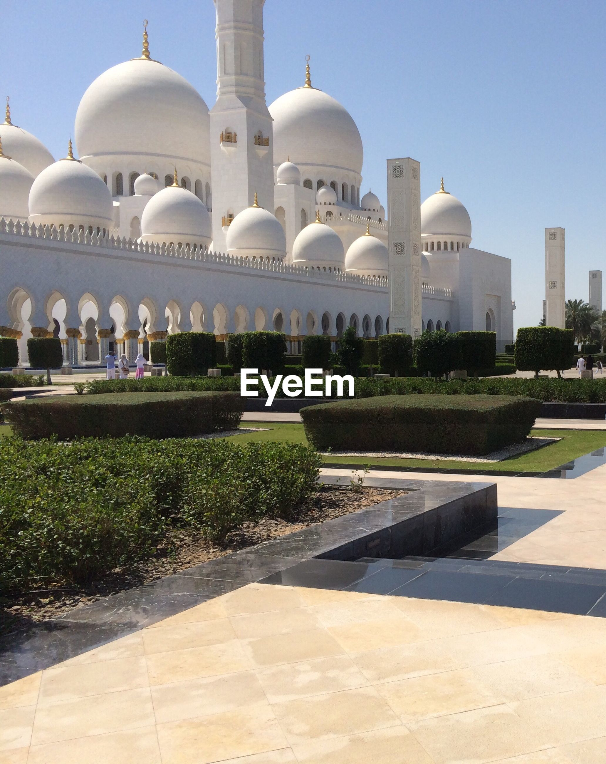 architecture, built structure, building exterior, dome, clear sky, famous place, travel destinations, mosque, islam, white color, place of worship, city, religion, tourism, travel, grass, day, church, international landmark