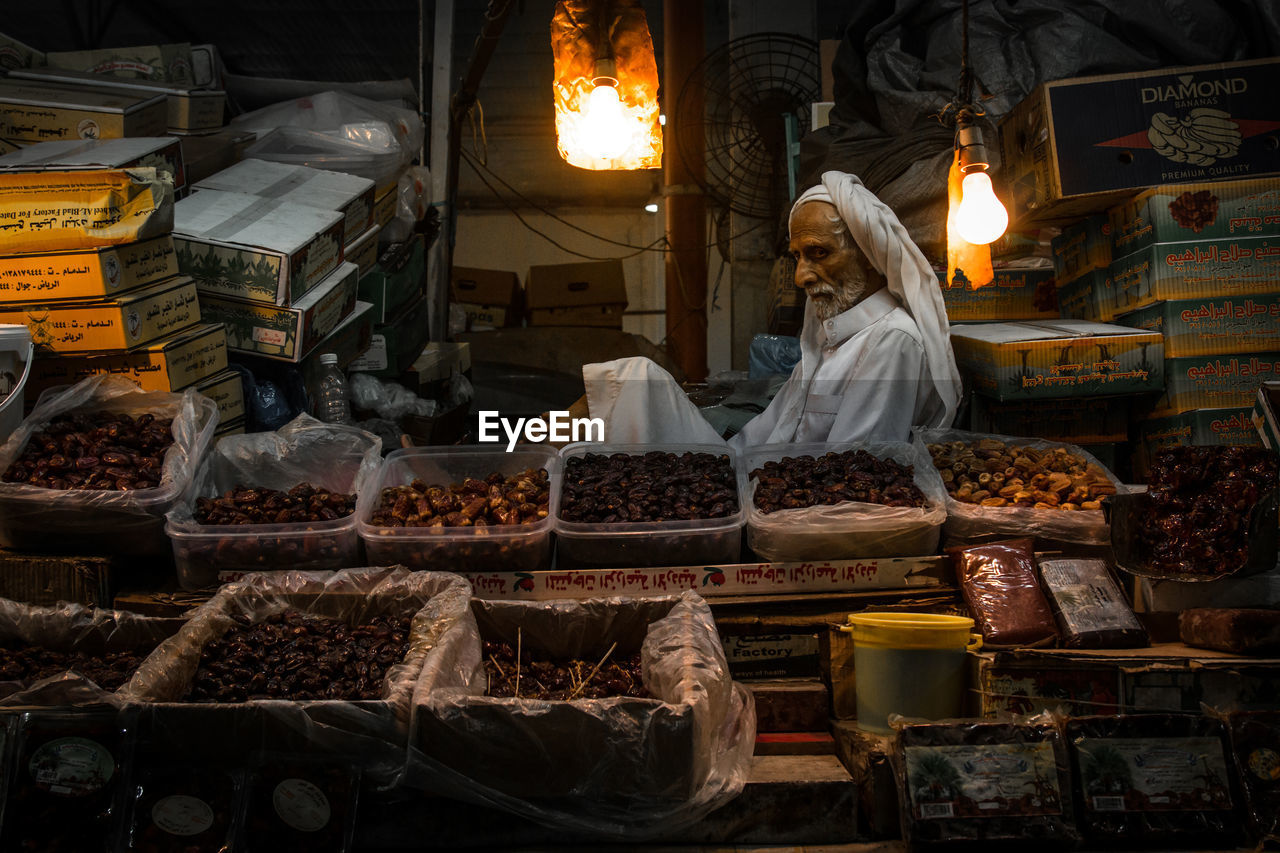 Vendor At Market Stall