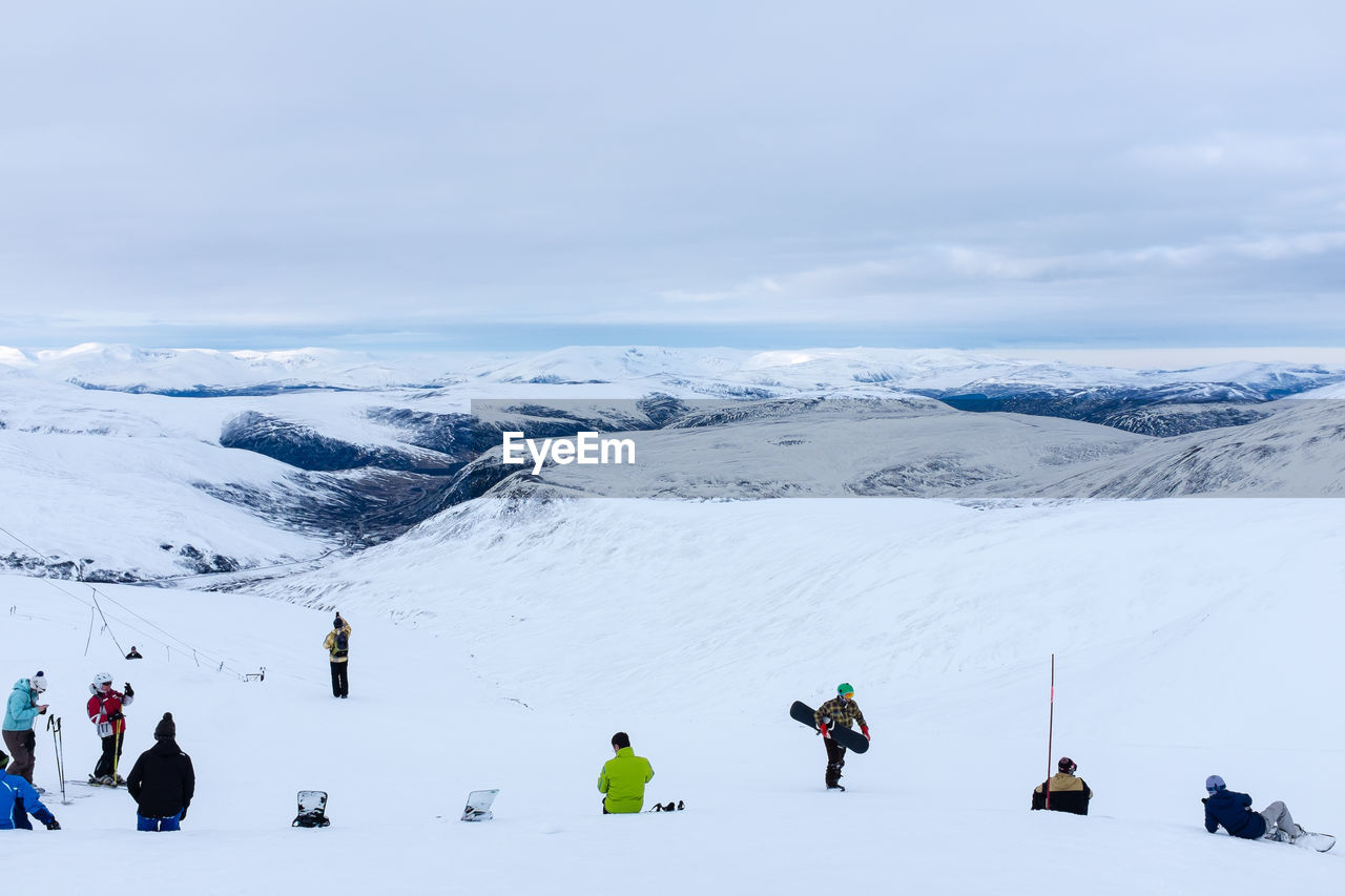 People On Snowcapped Mountain During Winter
