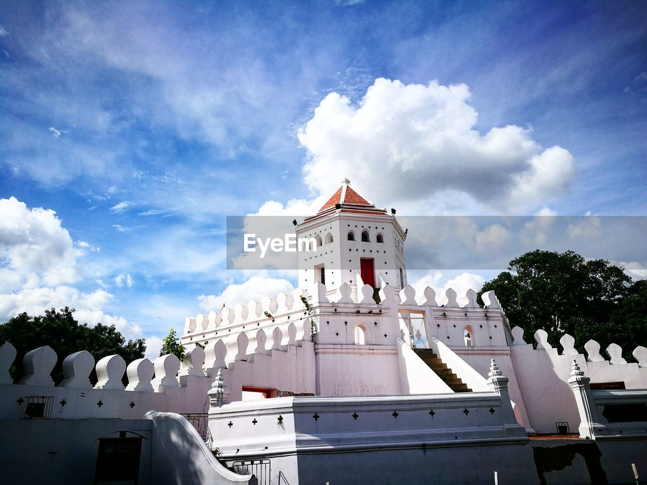 cloud - sky, sky, architecture, building exterior, religion, built structure, low angle view, spirituality, day, outdoors, place of worship, no people, tree, nature