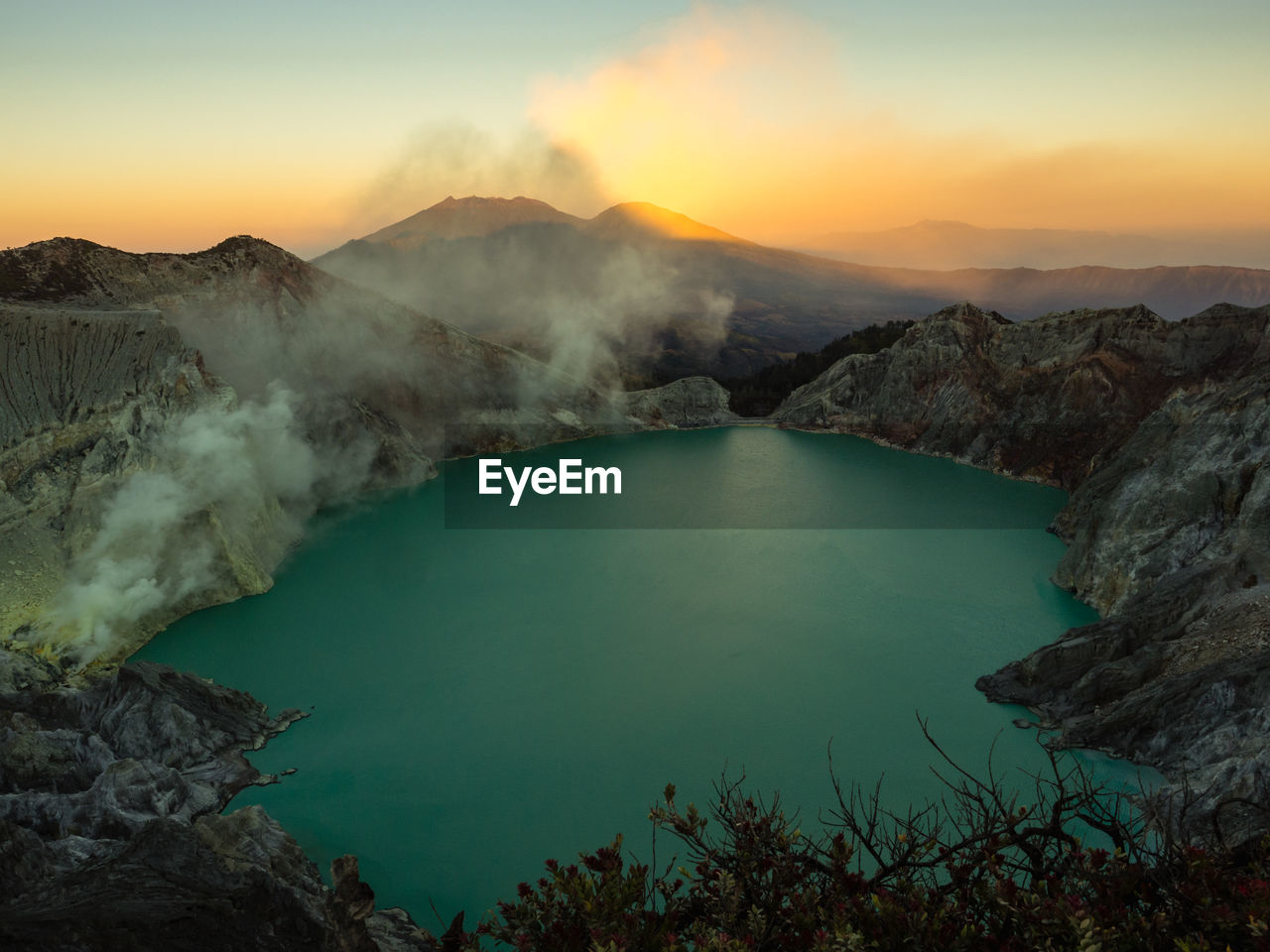 High angle view of crater lake against sky during sunset