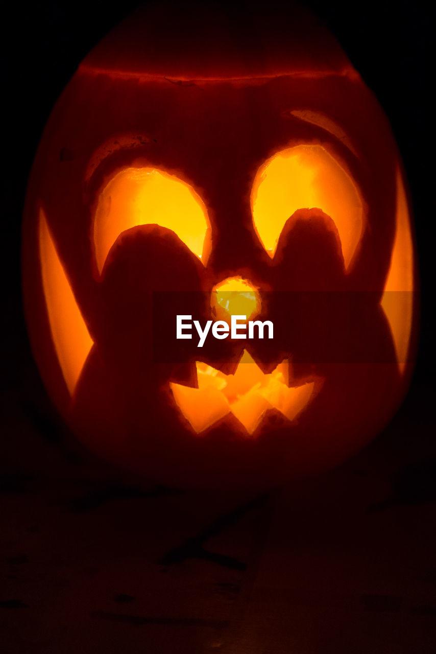 pumpkin, halloween, anthropomorphic face, orange color, jack o lantern, celebration, illuminated, night, holiday - event, no people, spooky, black background, jack o' lantern, studio shot, indoors, close-up