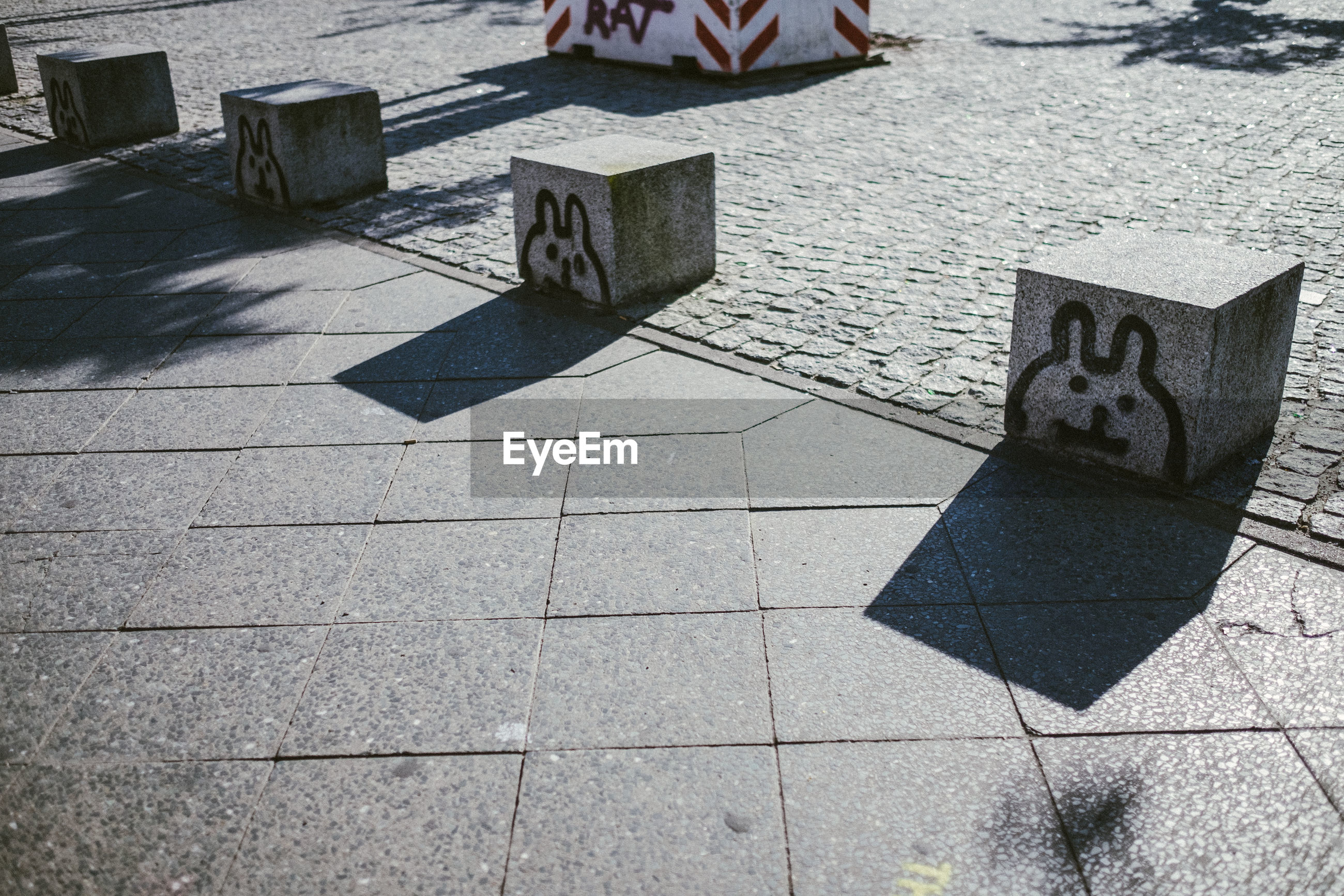 SHADOW OF TEXT ON THE GROUND