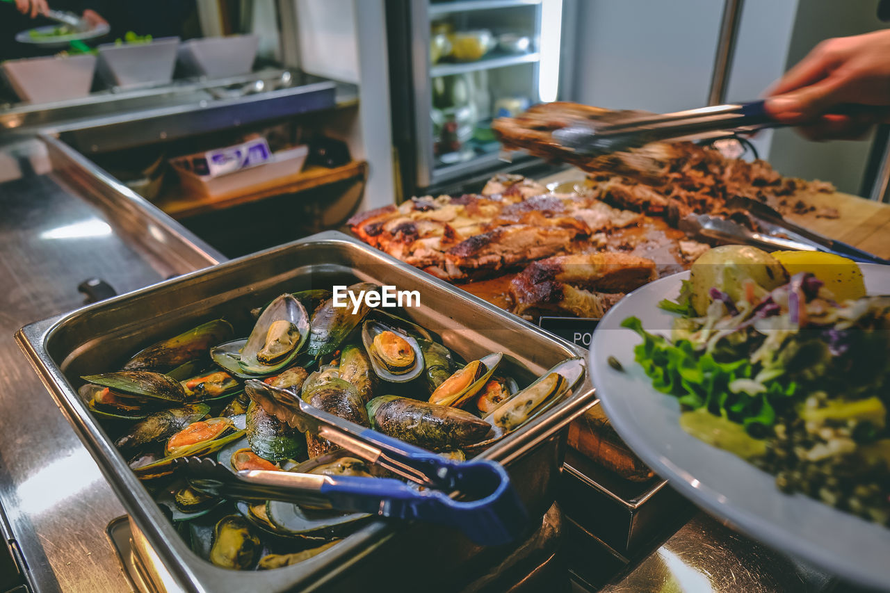 High angle view of food on table in restaurant. buffet mussels seafood dinner
