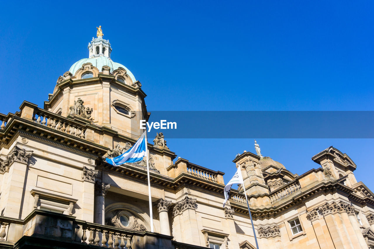 Low Angle View Of Bank Of Scotland Against Clear Blue Sky
