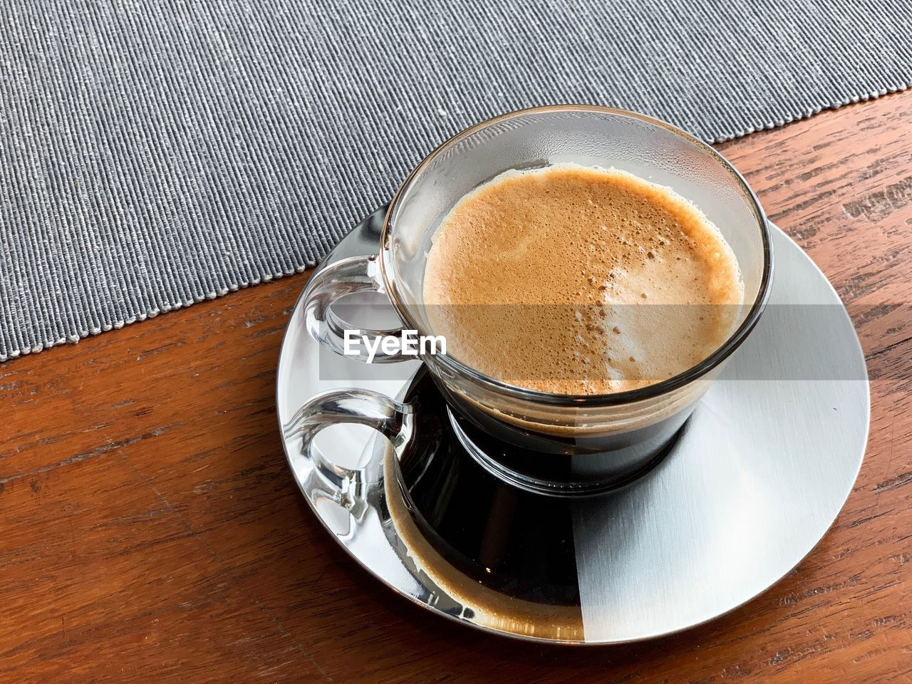 table, food and drink, coffee - drink, coffee, drink, saucer, cup, coffee cup, mug, still life, refreshment, freshness, high angle view, indoors, food, crockery, kitchen utensil, no people, frothy drink, wood - material, hot drink, non-alcoholic beverage, froth