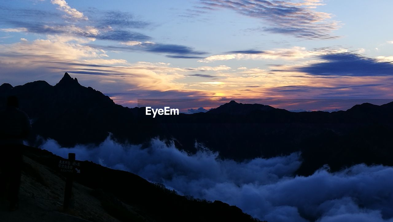 sky, cloud - sky, beauty in nature, mountain, scenics - nature, sunset, tranquil scene, tranquility, idyllic, silhouette, mountain range, nature, non-urban scene, no people, environment, orange color, outdoors, majestic, dramatic sky, mountain peak