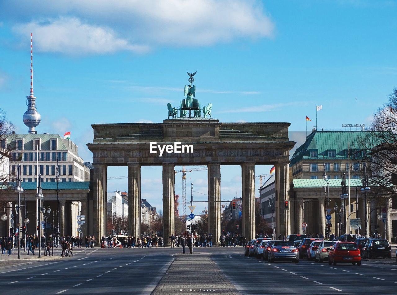 Brandenburg gate in city against blue sky