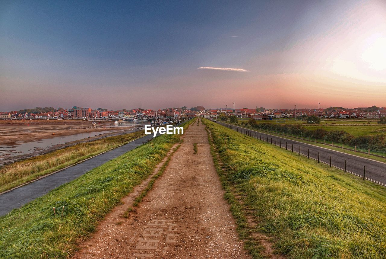 the way forward, sky, sunset, road, outdoors, no people, grass, nature, scenics, beauty in nature, building exterior, day