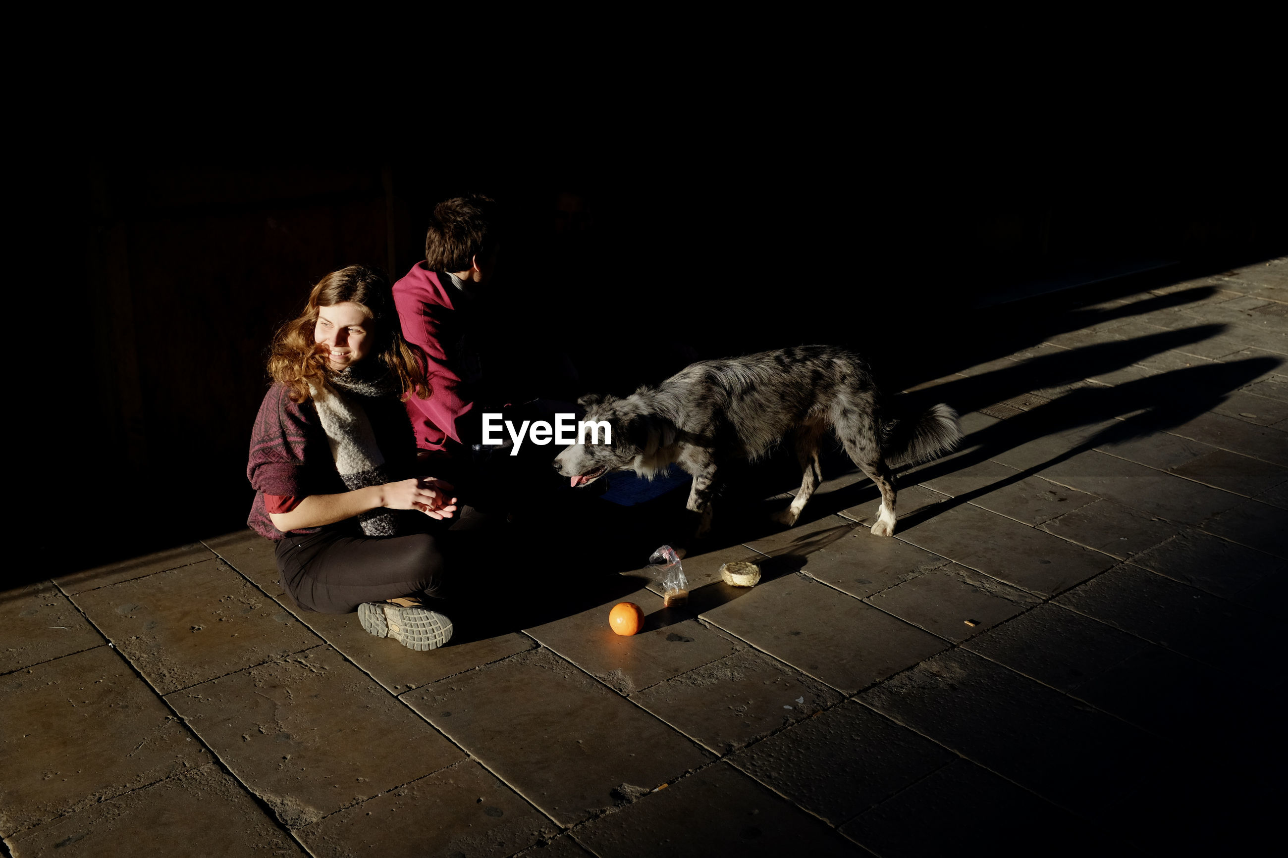 WOMAN WITH DOG IN A DARK