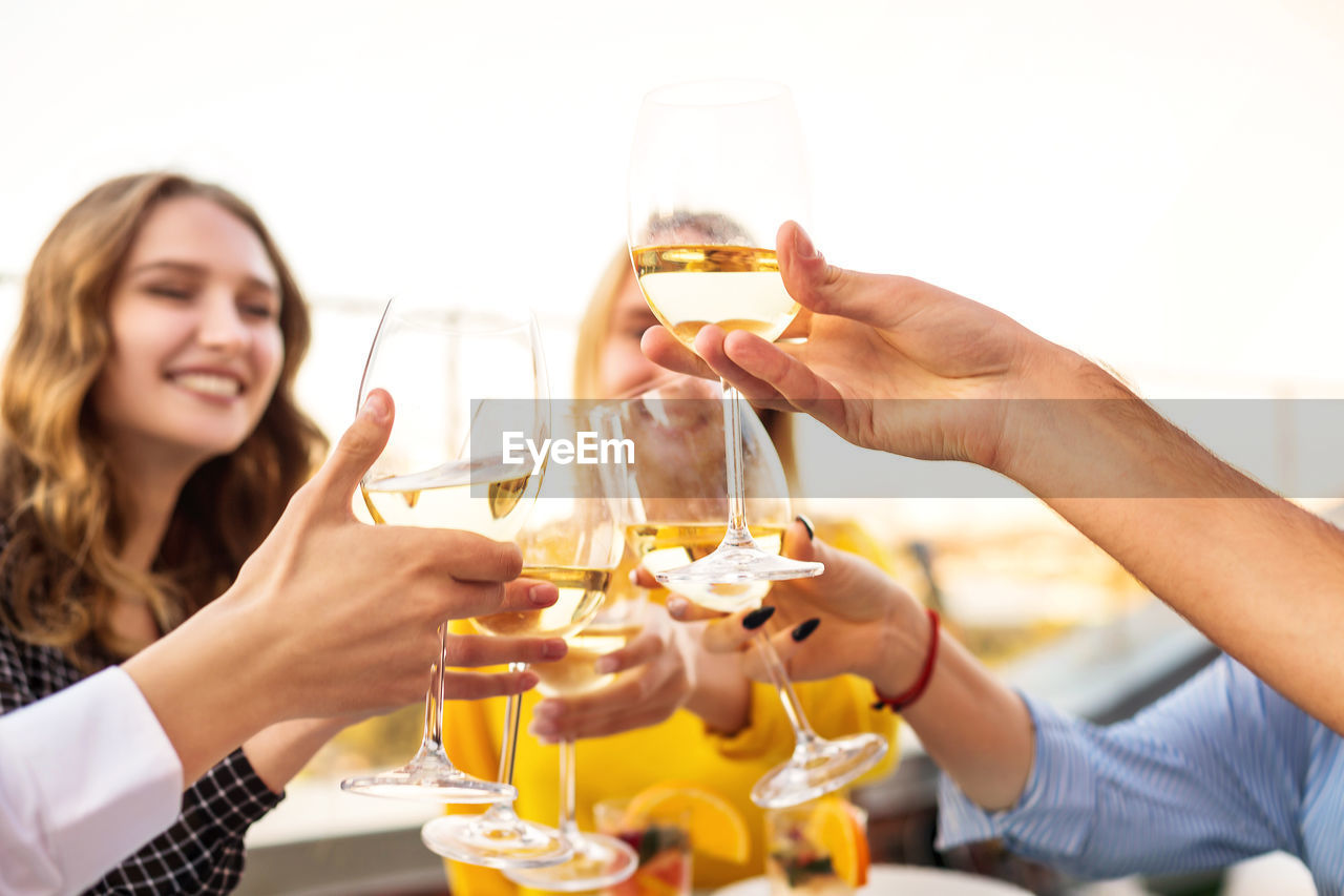 YOUNG WOMAN DRINKING WATER FROM GLASS AND DRINK