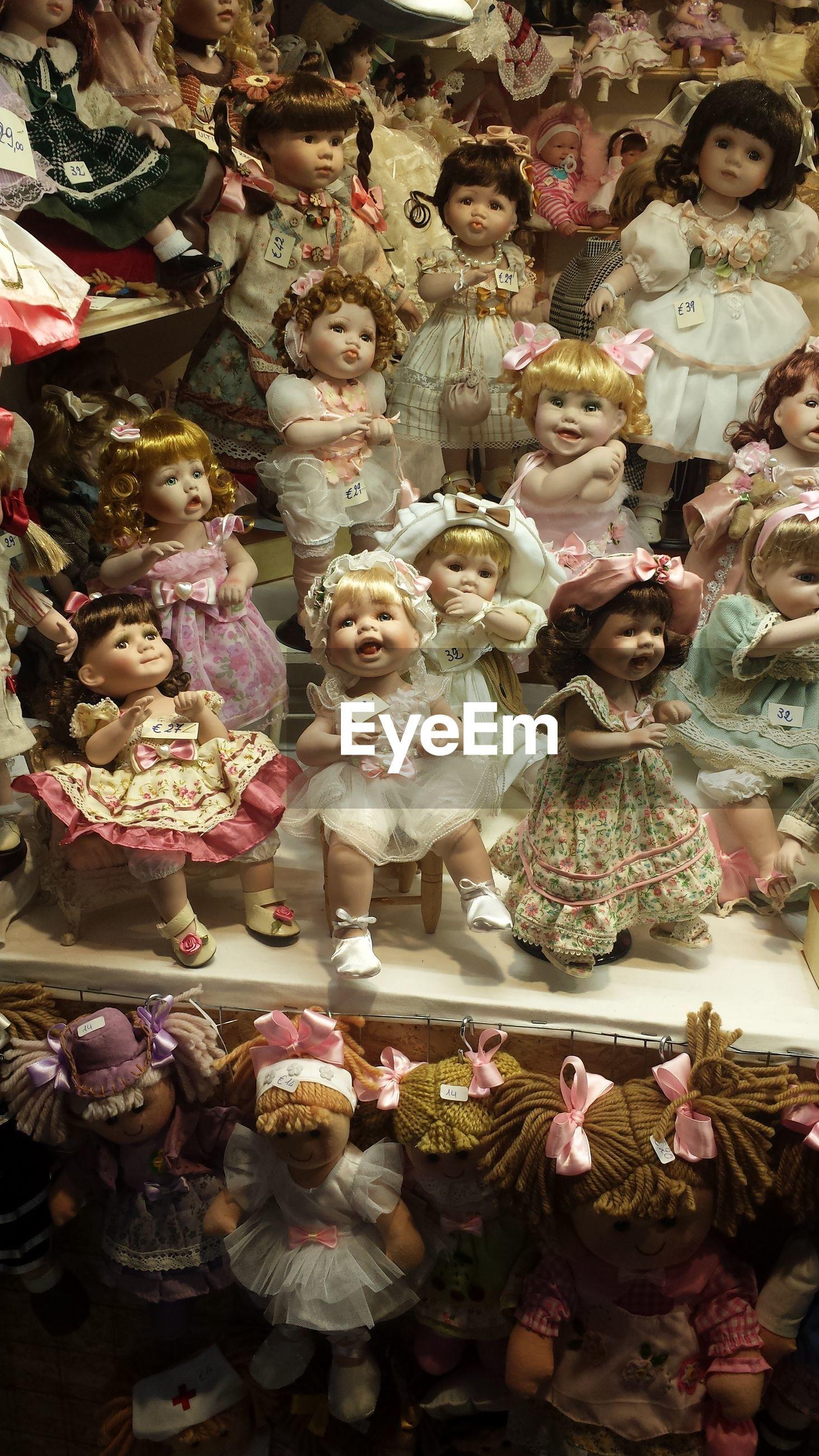 Full frame shot of dolls for sale in shop