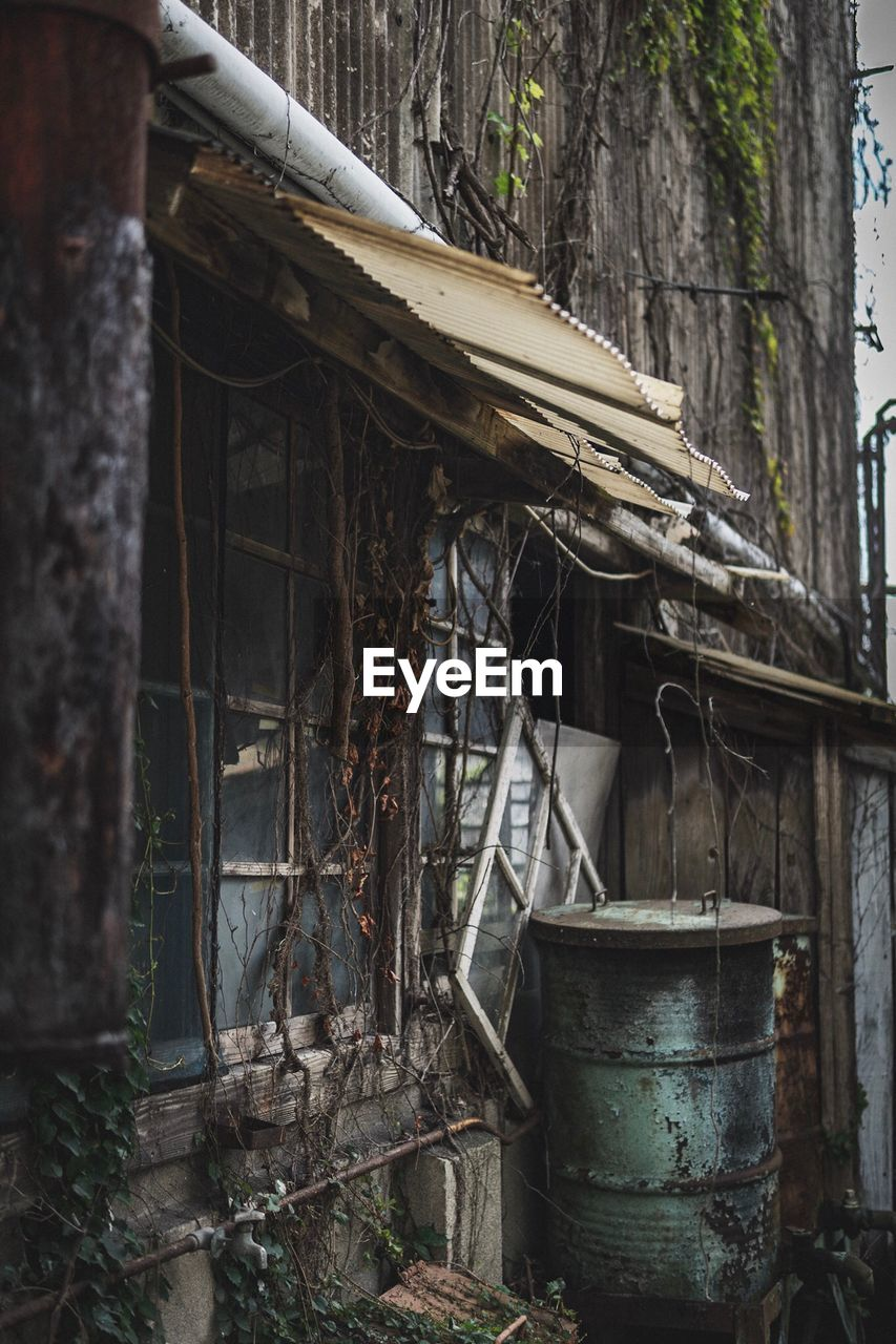 architecture, built structure, building, abandoned, no people, tree, building exterior, metal, day, wood - material, house, damaged, obsolete, old, nature, run-down, plant, outdoors, bad condition, decline, deterioration, ruined
