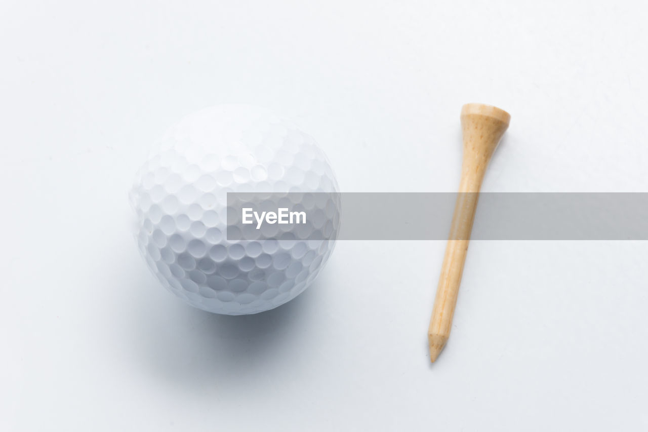 Directly above shot of golf ball over white background