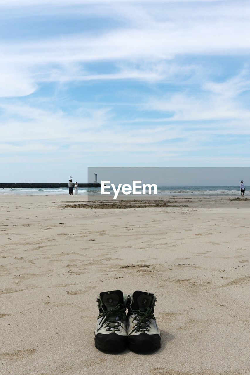 shoe, sky, beach, sea, sand, pair, horizon over water, nature, day, cloud - sky, beauty in nature, water, outdoors, scenics, no people