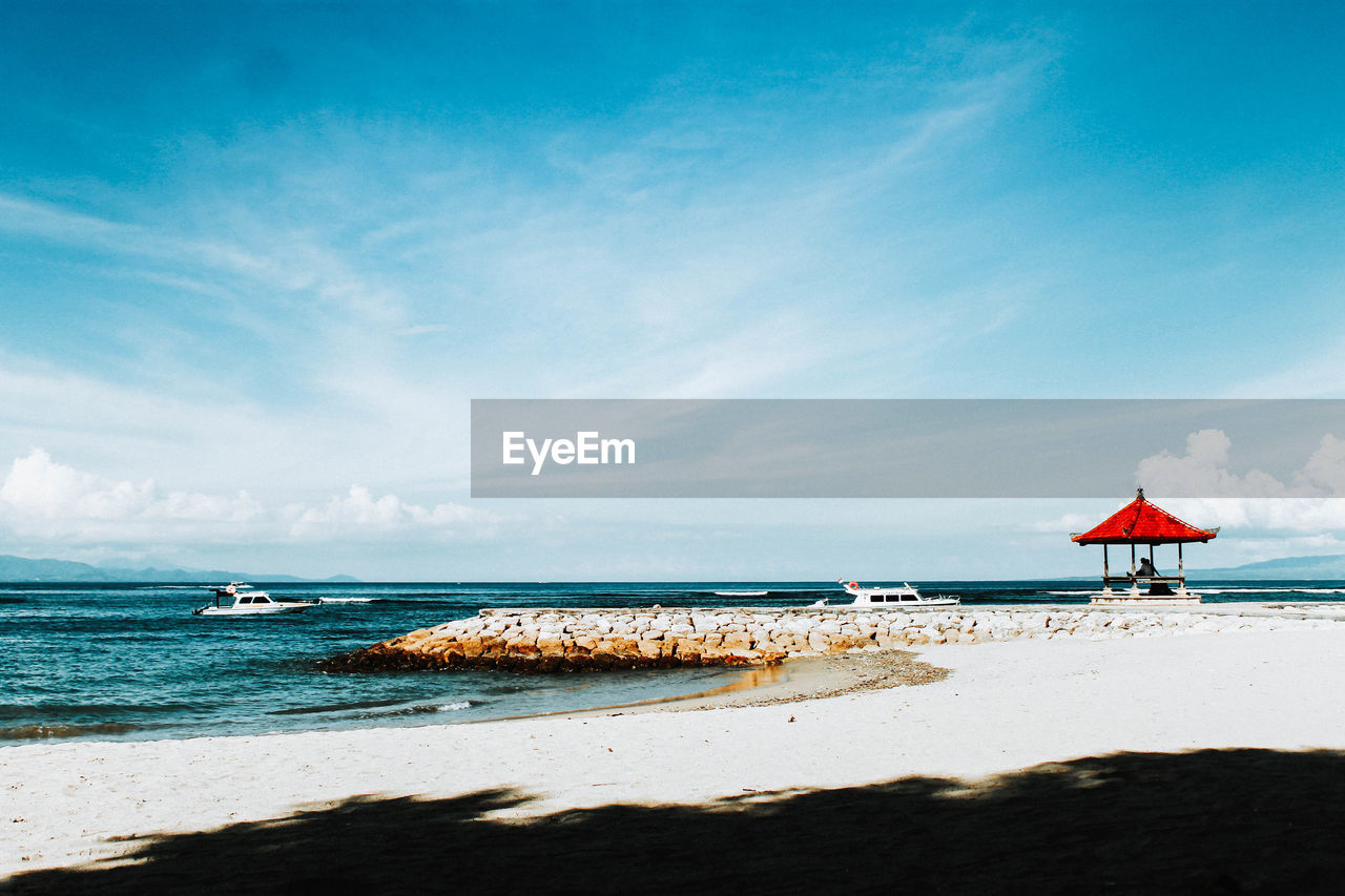 sea, water, beach, land, sky, horizon over water, horizon, sand, beauty in nature, scenics - nature, tranquility, cloud - sky, nature, tranquil scene, day, sunlight, blue, incidental people, idyllic, outdoors
