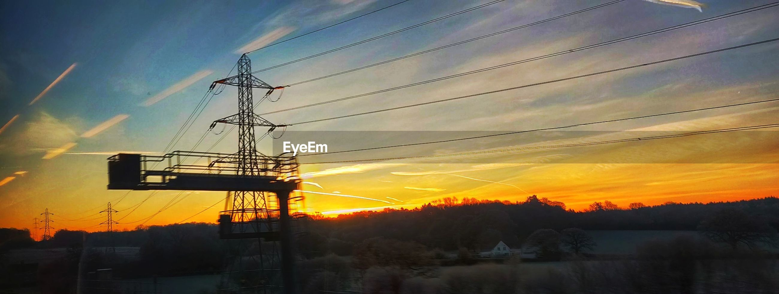 sky, sunset, cloud - sky, silhouette, orange color, nature, beauty in nature, no people, cable, scenics - nature, technology, fuel and power generation, tranquil scene, outdoors, power line, electricity pylon, tranquility, tree, plant, architecture, electricity, power supply