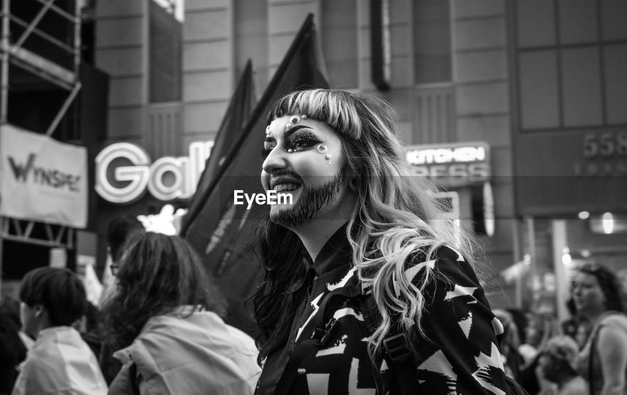 PORTRAIT OF WOMEN STANDING ON STREET