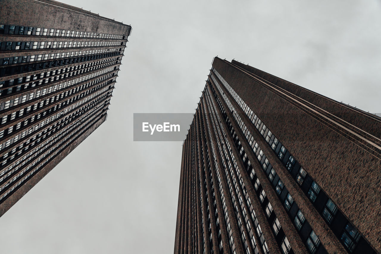 architecture, building exterior, built structure, low angle view, sky, building, city, modern, office building exterior, tall - high, office, nature, no people, skyscraper, tower, day, cloud - sky, outdoors, window, financial district