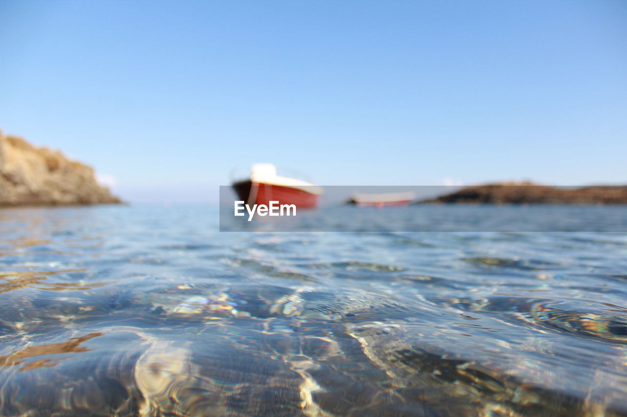 water, sky, sea, clear sky, waterfront, nature, copy space, no people, day, blue, surface level, tranquility, scenics - nature, beauty in nature, rippled, tranquil scene, rock, outdoors, land