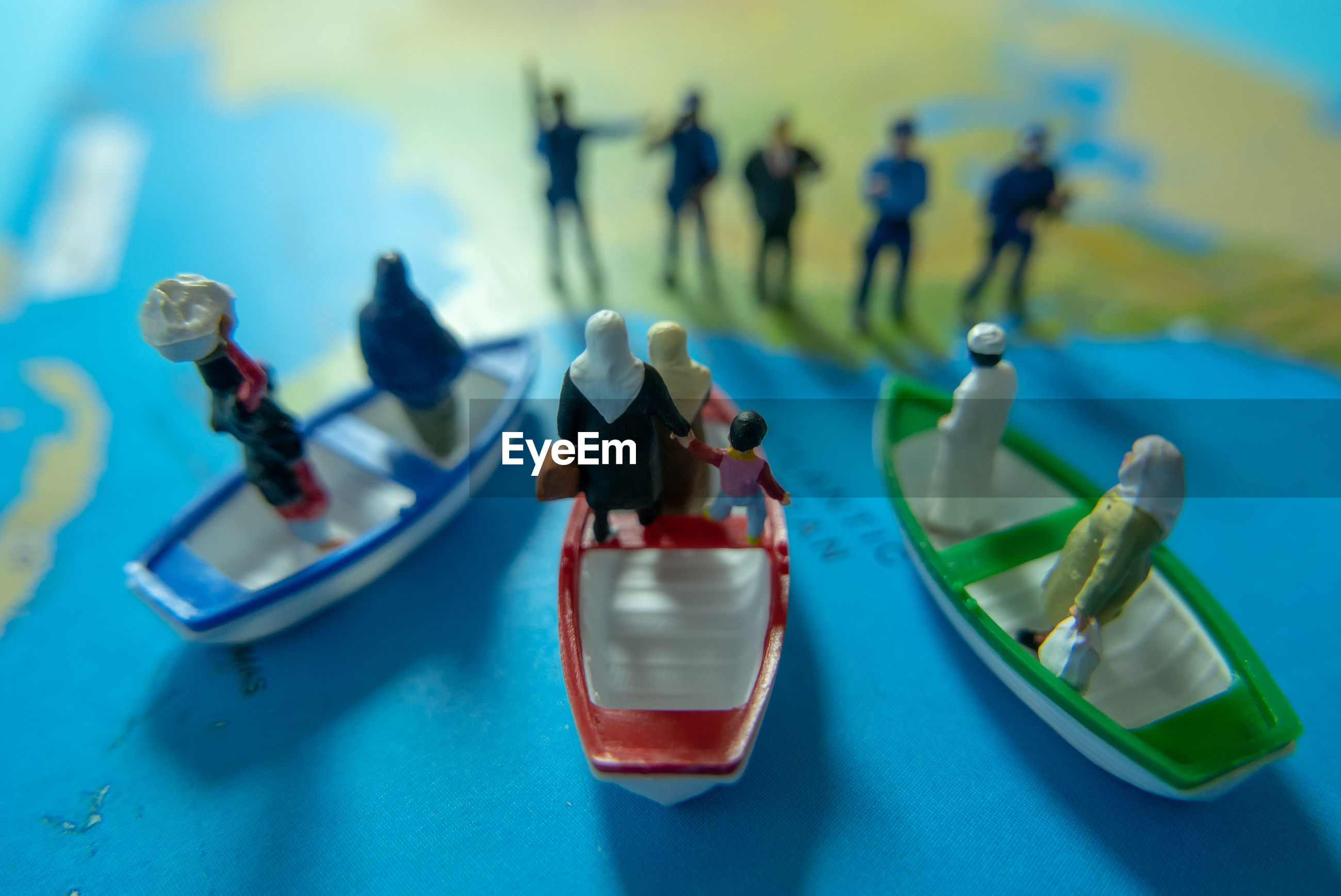 High angle view of figurines on map